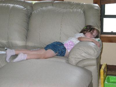 Tessa asleep on couch